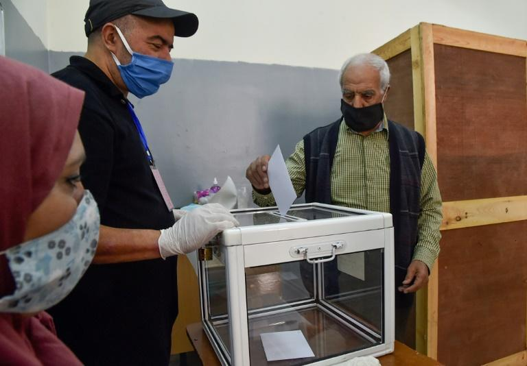 An Algerian man casts his ballot at a polling station in the capital Algiers during a referendum on a revised constitution