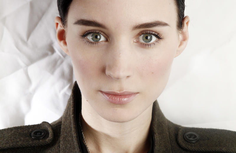 """FILE-  In this Saturday, Dec. 17, 2011 file photo, actress Rooney Mara poses for a portrait at the Crosby St. Hotel  in New York. It took Mara two and a half months and five screen tests to land the sought-after role of Lisbeth Salander, the fierce heroine in """"The Girl With the Dragon Tattoo.""""  (AP Photo/Carlo Allegri, FILE)"""