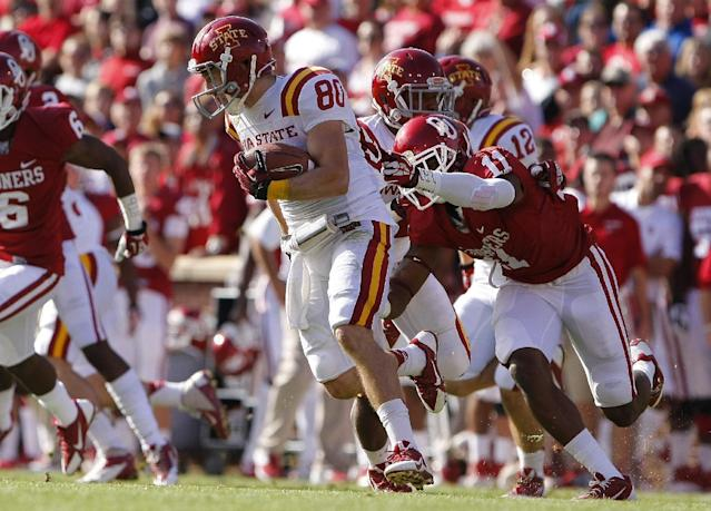 Iowa State's wide receiver Justin Coleman is tackled by Oklahoma's Lacoltan Bester in the first quarter of an NCAA college football game in Norman, Okla. on Saturday, Nov. 16, 2013. (AP Photo/Alonzo Adams)