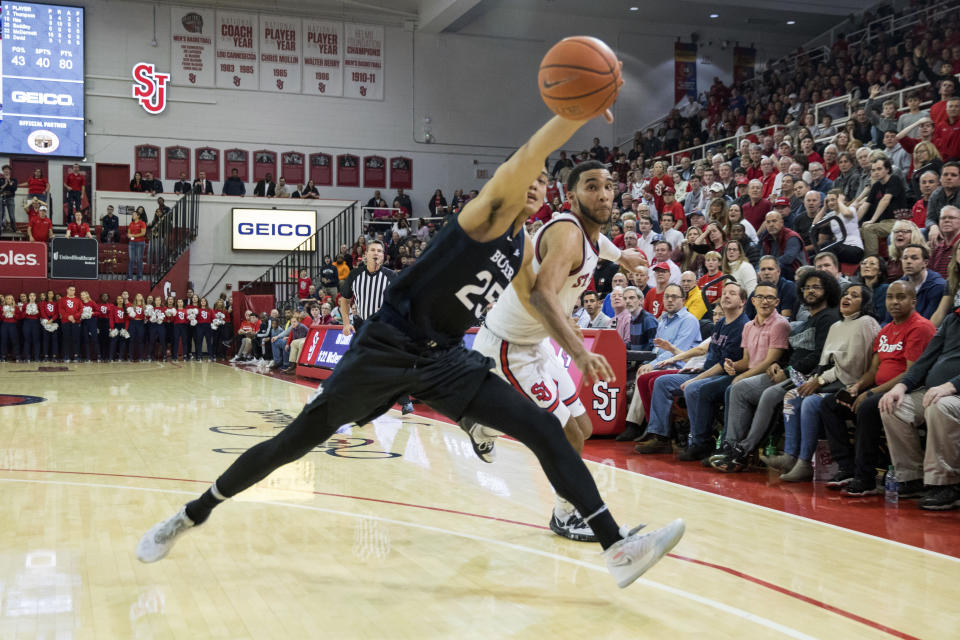 Butler forward Christian David (25) reaches for the ball during the second half of an NCAA college basketball game against St. John's, Tuesday, Dec. 31, 2019, in New York. (AP Photo/Julius Constantine Motal)