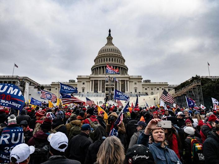 A detained protester is seen inside the U.S. Capitol as supporters of U.S. President Donald Trump protest outside, in Washington, U.S., January 6, 2021.