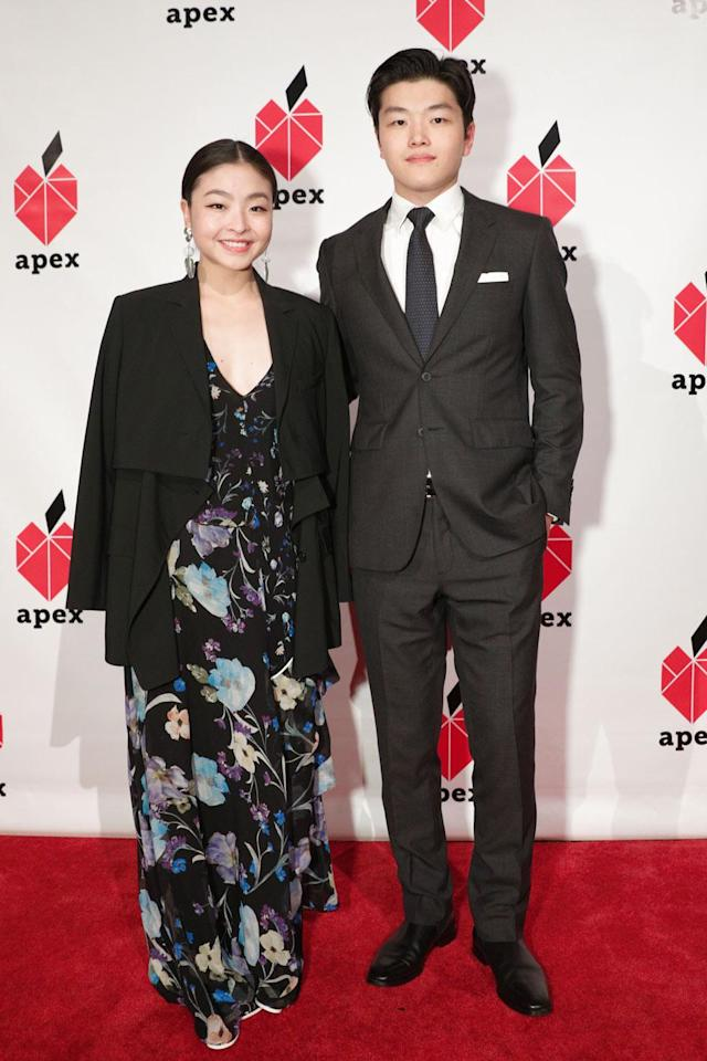 <p>Olympians Maia and Alex Shibutani turned up to support Apex for Youth. Maia wore a floral, cascading ruffle gown and black coat, while Alex opted for a svelte suit. (Photo: BFA/Courtesy of Apex for Youth) </p>