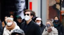 People wearing face masks are pictured at Schloss Strasse shopping street as the coronavirus disease (COVID-19) outbreak continues in Berlin