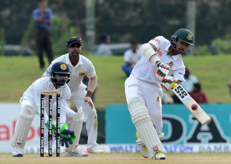 Bangladesh batsman Soumya Sarkar (R) plays a shot as Sri Lanka wicketkeeper Niroshan Dickwella looks on during the fourth day of the first Test at the Galle International Cricket Stadium in Galle on March 10, 2017