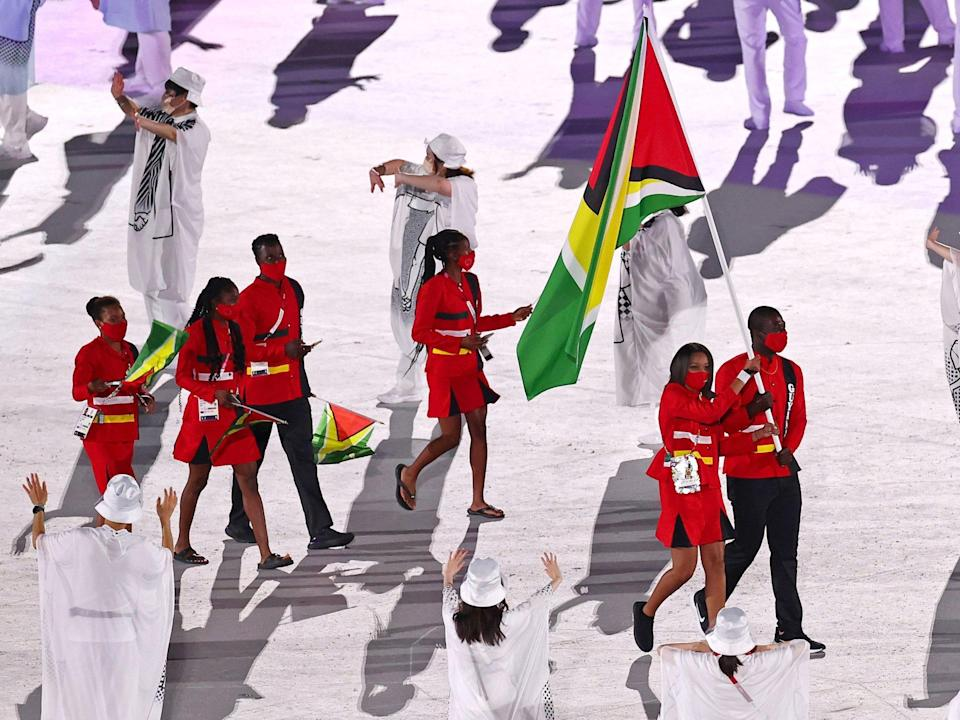 Athletes from Guyana make their entrance at the Summer Olympics.