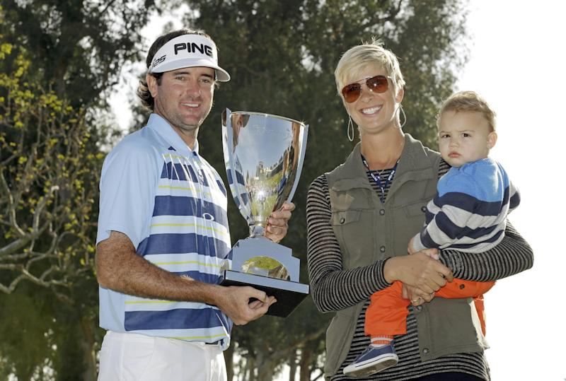Bubba Watson holds the winner's trophy with his wife Angie and son Caleb after his victory in the Northern Trust Open golf tournament at Riviera Country Club in the Pacific Palisades area of Los Angeles, Sunday, Feb. 16, 2014. Watson carded a 15-under-par 269, two strokes ahead of the second-place finisher. (AP Photo/Reed Saxon)