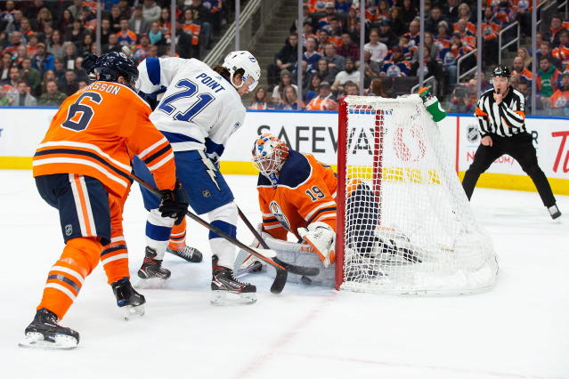 Edmonton Oilers goaltender Mikko Koskinen (19) makes a save against Tampa Bay Lightning center Brayden Point (21) during the first period of an NHL hockey game Saturday, Dec. 22, 2018, in Edmonton, Alberta. (Codie McLachlan/The Canadian Press via AP)