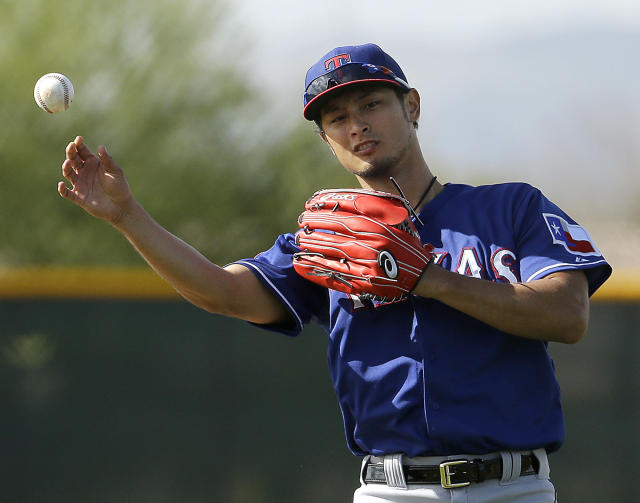 FIKE - In this Feb. 22, 2015, file photo, Texas Rangers pitcher Yu Darvish throws during spring training baseball practice in Surprise, Ariz. Darvish made his spring debut after last season ended prematurely for him due to elbow inflammation. (AP Photo/Charlie Riedel, File)
