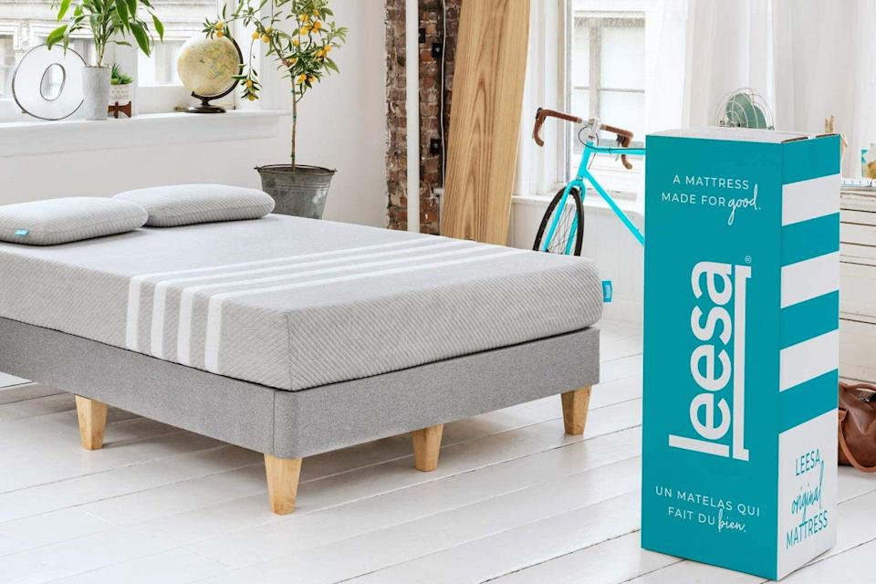 Grey and white striped mattress and mattress box