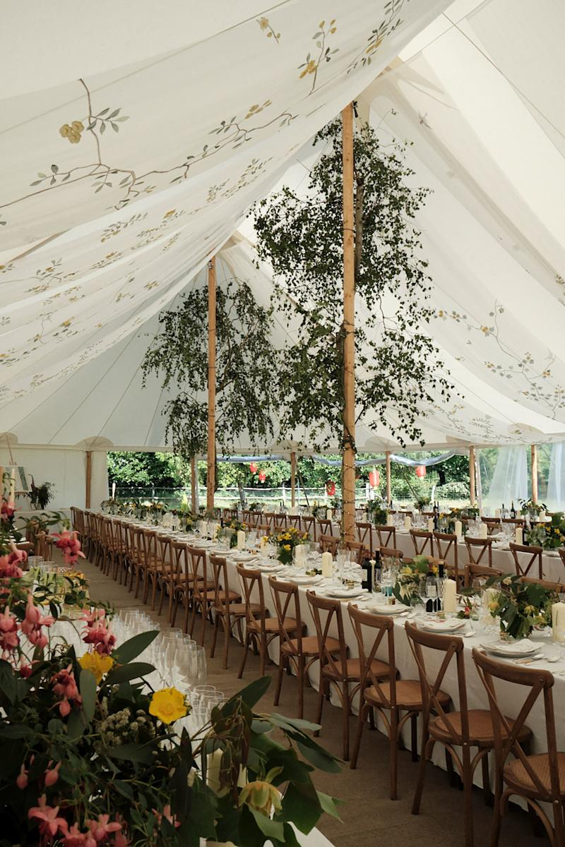The silver birch trees were cut down from the woods by Jake the day before the wedding and tied to the central poles of the tent. They looked like they were growing from the middle of the marquee and framed the organza beautifully.