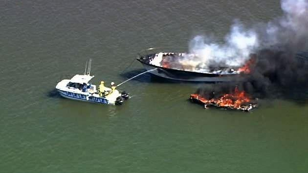 Emergency crews have been working with portable pumps to extinguish the blaze. Source: 7News