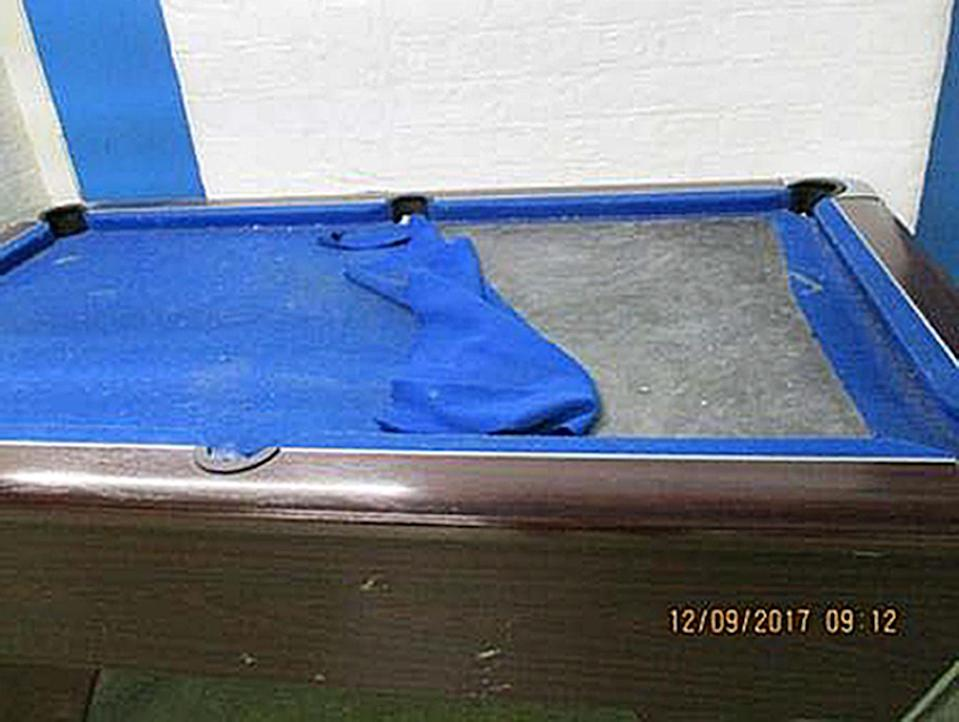 A wrecked pool table at HMP Liverpool (PA)