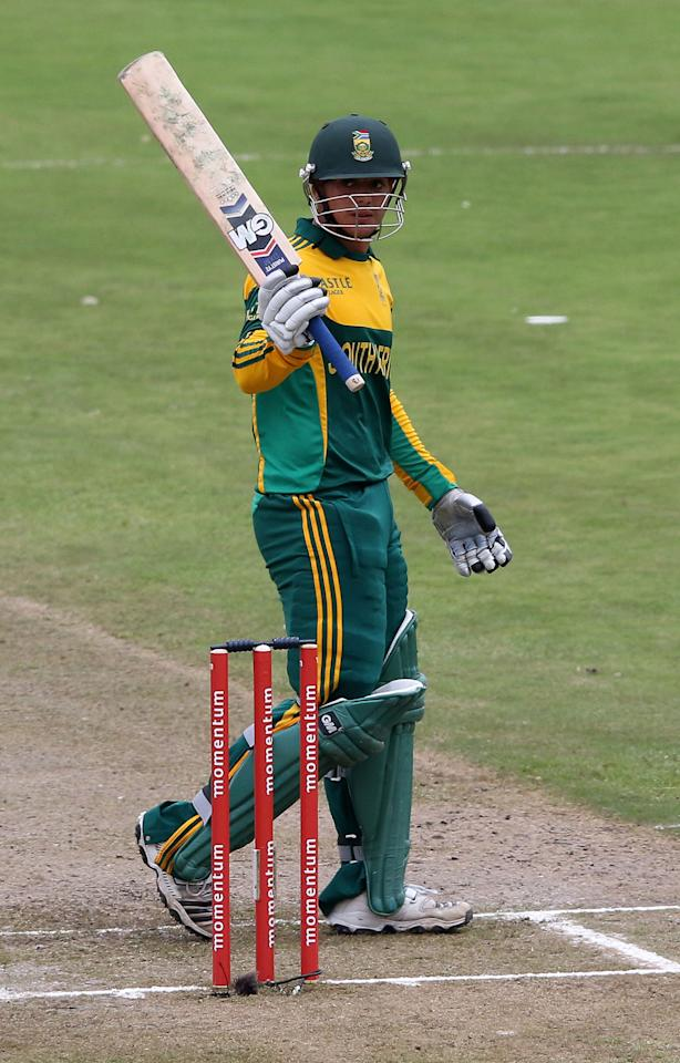 DURBAN, SOUTH AFRICA - DECEMBER 08: Quinton de Kock reaches 50 runs  during the 2nd Momentum ODI match between South Africa and India at Sahara Stadium Kingsmead on December 08, 2013 in Durban, South Africa. (Photo by Anesh Debiky/Gallo Images/Getty Images)