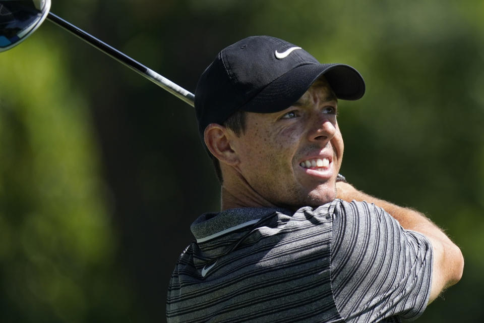 Rory McIlroy, of Northern Ireland, watches his tee shot on the third hole during the second round of the Charles Schwab Challenge golf tournament at the Colonial Country Club in Fort Worth, Texas, Friday, June 12, 2020. (AP Photo/David J. Phillip)