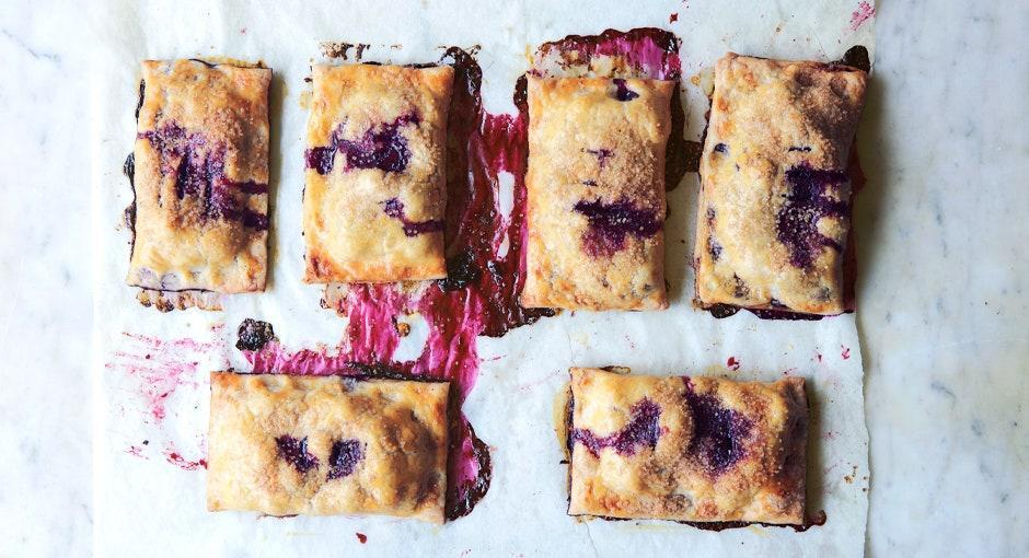 """These handheld pastries deliver the perfect filling-to-crust ratio. <a href=""""https://www.bonappetit.com/recipe/blueberry-hand-pies?mbid=synd_yahoo_rss"""" rel=""""nofollow noopener"""" target=""""_blank"""" data-ylk=""""slk:See recipe."""" class=""""link rapid-noclick-resp"""">See recipe.</a>"""