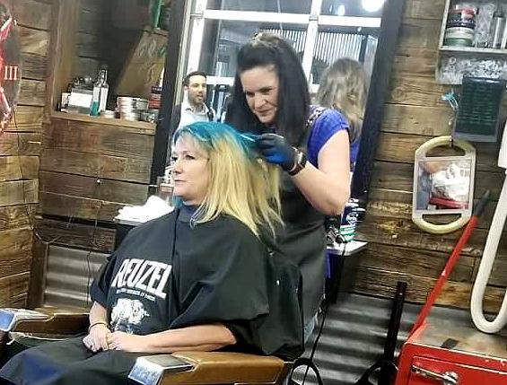 Mail carrier Candace Lincoln gets her hair dyed blue at Beardsmith in Boise to raise awareness for the Stamp Out Hunger food drive. (Photo: Courtesy of Candace Lincoln)