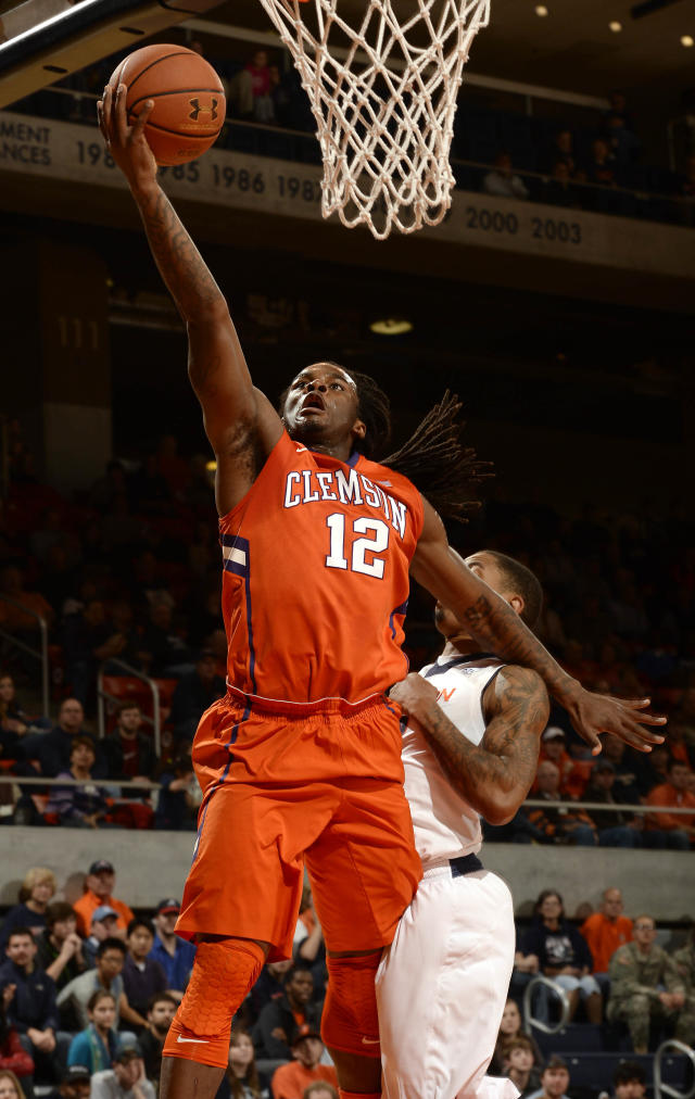 Clemson's Rod Hall (12) lays in a basket around Auburn's Allen Payne in the first half of an NCAA college basketball game on Thursday, Dec. 19, 2013, in Auburn, Ala.(AP Photo/Todd J. Van Emst)