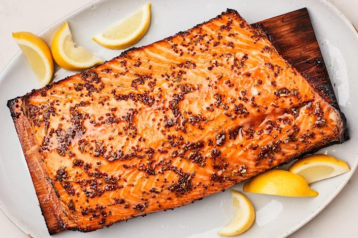 """Here's the salmon recipe you need if you have friends coming over for a cookout. It's simply seasoned with grainy mustard, rosemary, honey or maple syrup, and lemon zest, but grilling on the plank adds a whisper of smoky flavor. <a href=""""https://www.epicurious.com/recipes/food/views/cedar-plank-salmon-354516?mbid=synd_yahoo_rss"""" rel=""""nofollow noopener"""" target=""""_blank"""" data-ylk=""""slk:See recipe."""" class=""""link rapid-noclick-resp"""">See recipe.</a>"""