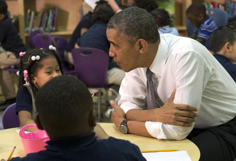 """President Barack Obama greets a pre-Kindergarten class of children at Moravia Park Elementary School in Baltimore, Friday, May 17, 2013, during his second """"Middle Class Jobs and Opportunity Tour"""". (AP Photo/Jacquelyn Martin)"""