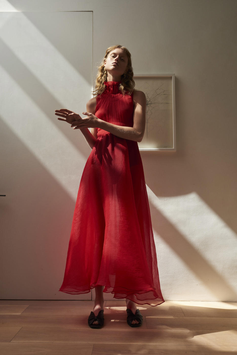 <p><i>Model wears a high-neck, red chiffon dress from the Beaufille SS18 collection. (Photo: ImaxTree) </i></p>