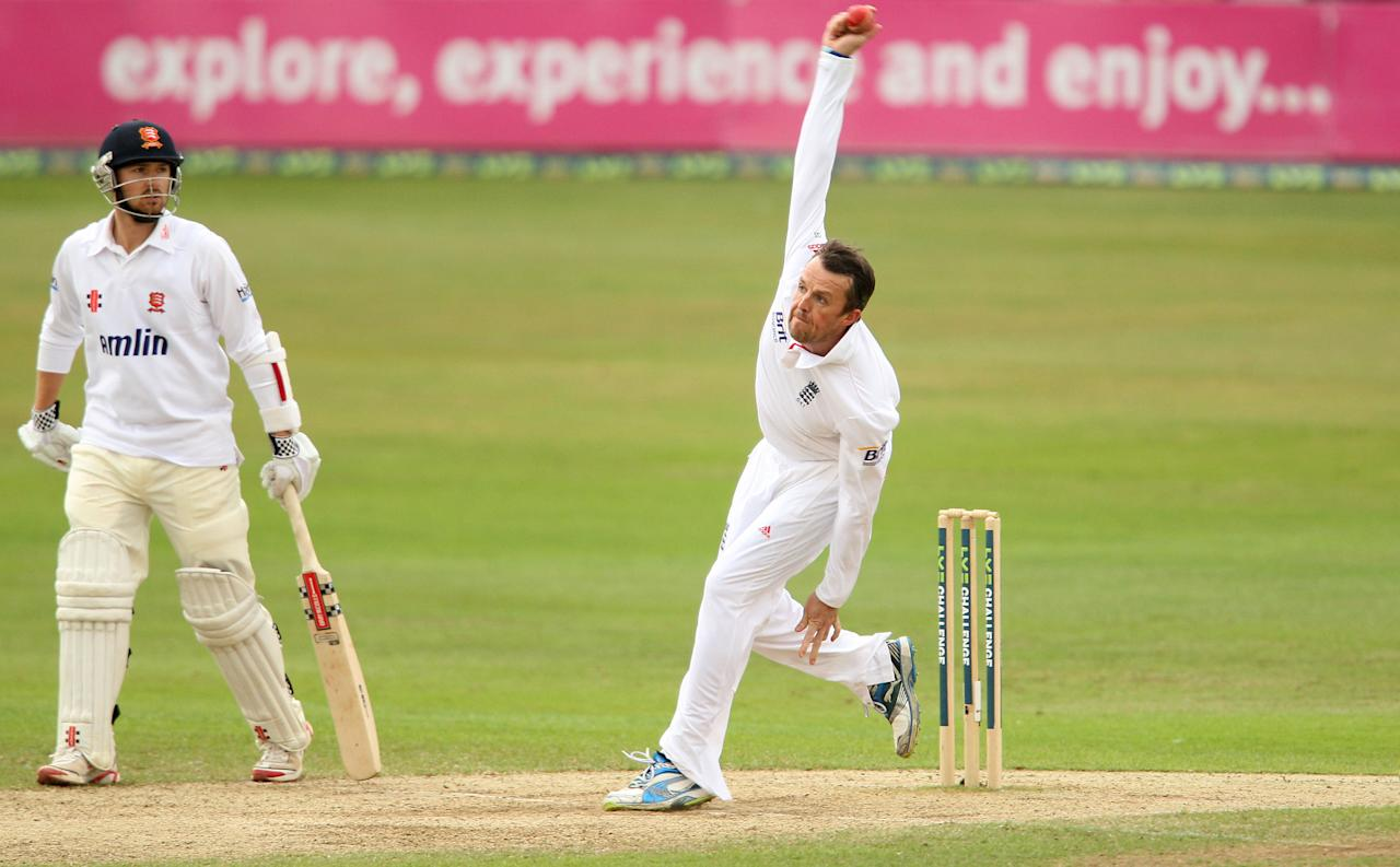 England's Graeme Swann bowls during day four of the International Tour match at The County Ground, Chelmsford.