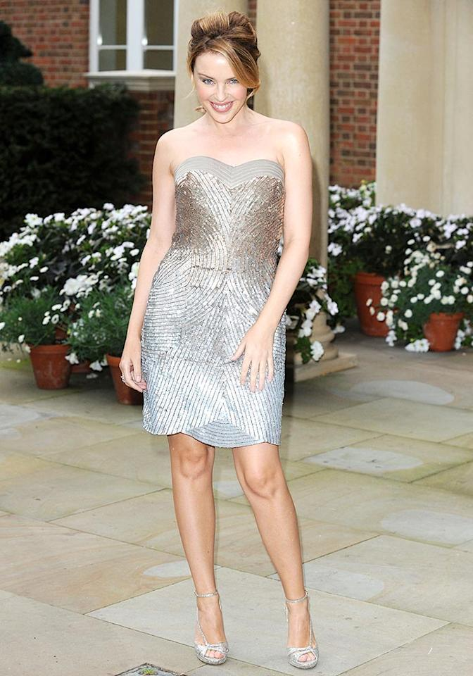 "Speaking of sparkles, pint-size pop star Kylie Minogue attended the London launch of her luxurious bed linen line in a marvelous mini and matching metallic heels. James Whatling/<a href=""http://www.splashnewsonline.com"" target=""new"">Splash News</a> - September 7, 2009"