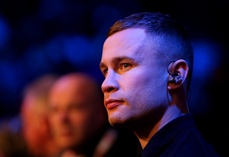 Carl Frampton is seen ringside.