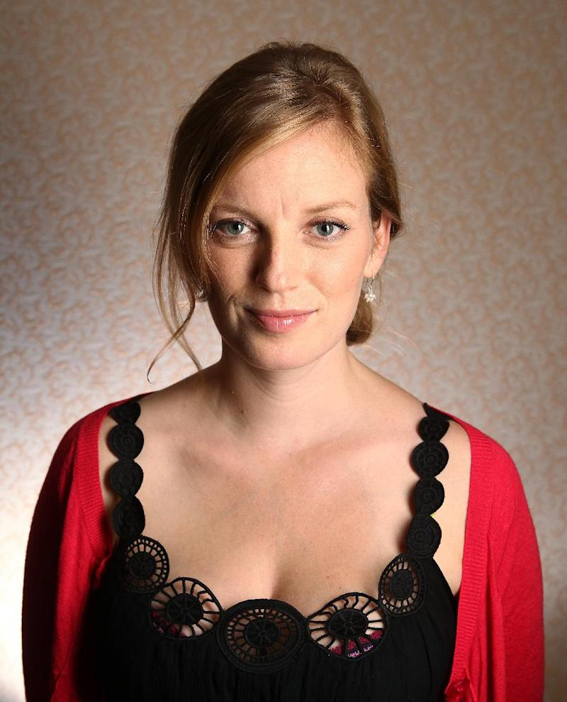 "FILE - In this Sept. 11, 2011 file photo, director-screenwriter-actress Sarah Polley poses for a portrait to promote her film, ""Take this Waltz,"" during the 36th Toronto International Film Festival in Toronto, Canada. Polley's ""Take This Waltz"" starring Michelle Williams and Seth Rogen as a married couple stressed by the temptation of an affair, will be shown at the Tribeca Film Festival.  (AP Photo/Carlo Allegri, file)"