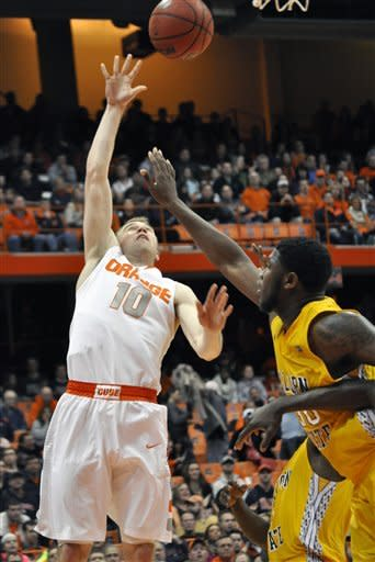 Syracuse's Trevor Cooney soots over Alcorn State's Jamaal Hester during the second half of an NCAA college basketball game in Syracuse, N.Y., Saturday, Dec. 29, 2012. Syracuse won 57-36. (AP Photo/Kevin Rivoli)