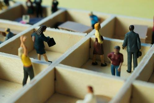 """<span class=""""caption"""">The great separation. </span> <span class=""""attribution""""><a class=""""link rapid-noclick-resp"""" href=""""https://www.shutterstock.com/image-photo/miniature-people-separated-office-cubicles-sterile-1565199076"""" rel=""""nofollow noopener"""" target=""""_blank"""" data-ylk=""""slk:Zenza Flarini"""">Zenza Flarini</a></span>"""