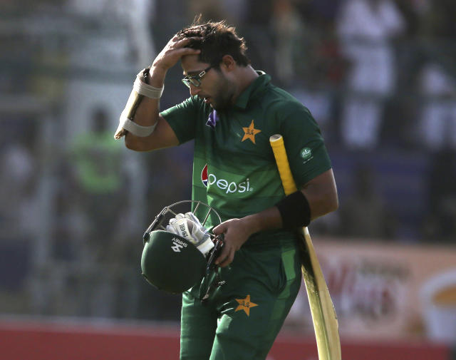Pakistan's Imam-ul-Haq on his way to pavilion after being dismissed by Sri Lanka, in Karachi, Pakistan, Monday, Sept. 30, 2019. Pakistan play a second one-day international after winning the toss and elected to bat against Sri Lanka. (AP Photo/Fareed Khan)