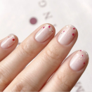 """<p>Patriotic nails doesn't <em>always</em> necessarily mean red, white and blue. Channel fireworks with simple, festive dots in any color. Make sure to add some sparkles!</p><p><a class=""""link rapid-noclick-resp"""" href=""""https://www.amazon.com/Double-Ended-Dotting-Marbling-Cheeky%C2%AE/dp/B005FJQQMC?tag=syn-yahoo-20&ascsubtag=%5Bartid%7C10055.g.1278%5Bsrc%7Cyahoo-us"""" rel=""""nofollow noopener"""" target=""""_blank"""" data-ylk=""""slk:SHOP DOTTING TOOLS"""">SHOP DOTTING TOOLS</a></p>"""