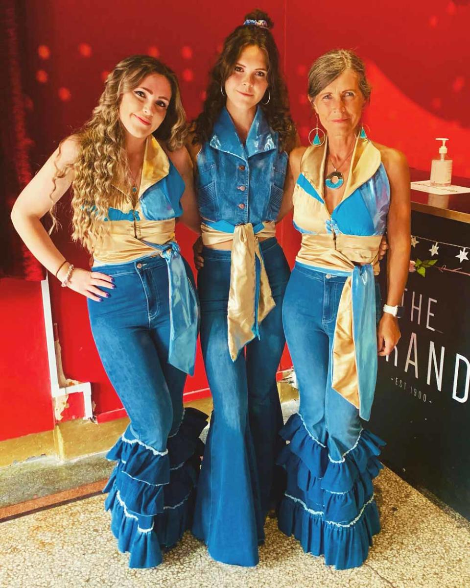 Jane and her two daughters, Lucy and Chloe, love dressing up for ABBA events (Collect/PA Real Life).