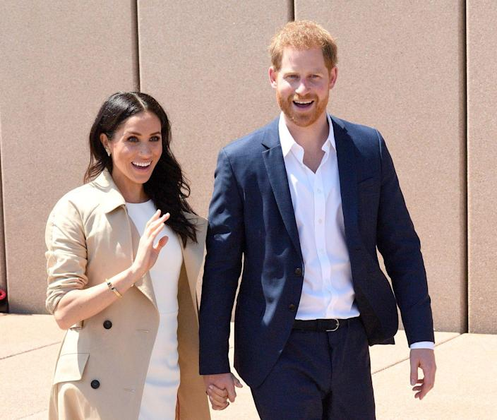 <p>Harry and Meghan are all smiles after the announcement of Meghan's pregnancy. Their tour of Oceania was their first public appearance since the news went public.</p>