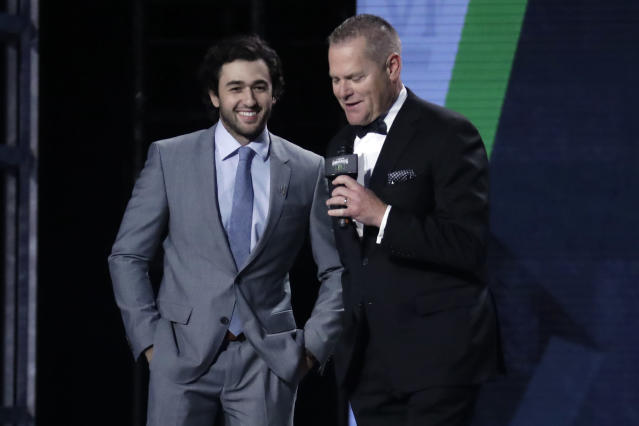 NASCAR driver Chase Elliott, left, is interviewed after being named the most popular driver at the NASCAR Cup Series Awards Thursday, Dec. 5, 2019, in Nashville, Tenn. (AP Photo/Mark Humphrey)