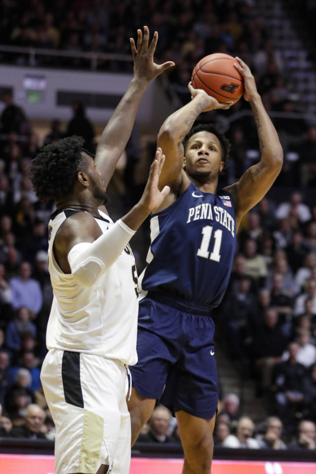 Penn State forward Lamar Stevens (11) shoots over Purdue forward Trevion Williams (50) during the first half of an NCAA college basketball game in West Lafayette, Ind., Tuesday, Feb. 11, 2020. (AP Photo/Michael Conroy)