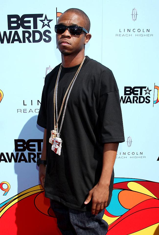 "Chamillionaire accessorized his black tee and jeans with a little bling. Too bad he couldn't flash a smile! Arnold Turner/<a href=""http://www.wireimage.com"" target=""new"">WireImage.com</a> - June 28, 2009"