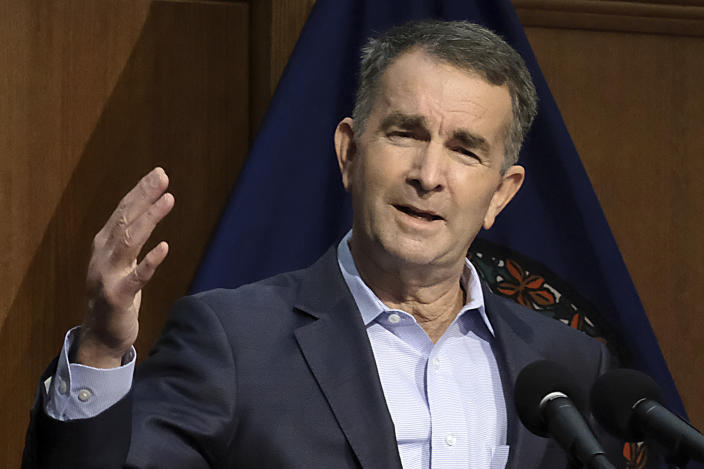 Virginia Gov. Ralph Northam addresses the public and the media while giving new restriction orders for Virginians dealing with the coronavirus during a press conference at the Patrick Henry Building in Richmond, Va., Thursday, Dec. 10, 2020. (Bob Brown/Richmond Times-Dispatch via AP)