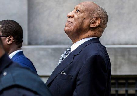 FILE PHOTO: Bill Cosby leans back to listens to words of encouragement from onlookers outside Montgomery County Courthouse in Norristown