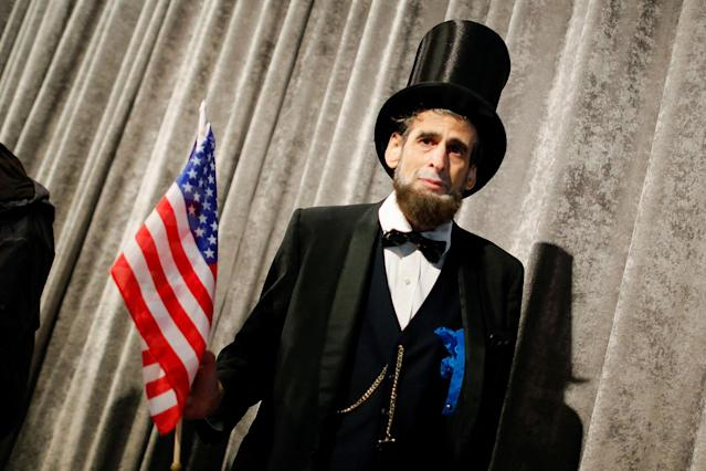 <p>A man disguised as former U.S. president Abraham Lincoln attends an annual Memorial Day commemoration ceremony to honor the men and women who made the ultimate sacrifice while serving in the United States Armed Forces, at the Intrepid museum in New York, U.S., May 29, 2017. (Photo: Eduardo Munoz/Reuters) </p>