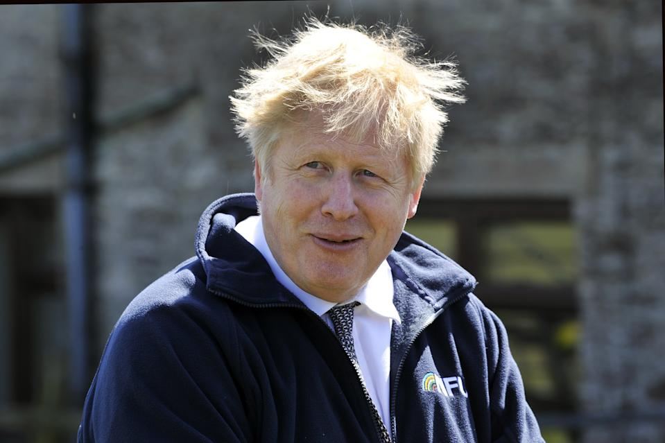 Prime Minister Boris Johnson during a visit to the Moor Farm in Stoney Middleton, north Derbyshire on the local election campaign trail. Picture date: Friday April 23, 2021.