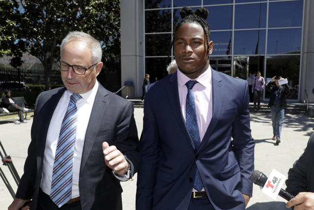 San Francisco 49ers linebacker Reuben Foster, right, leaves the Santa Clara County Superior Court, with his attorney Joshua Bentley after a preliminary hearing stemming from domestic violence accusations against Foster Thursday, May 17, 2018, in San Jose, Calif. Foster's ex-girlfriend, Elissa Ennis, recanted allegations Thursday that Foster physically assaulted her. She testified that she lied to authorities about the domestic assault to get back at Foster for breaking up with her. (AP Photo/Marcio Jose Sanchez)