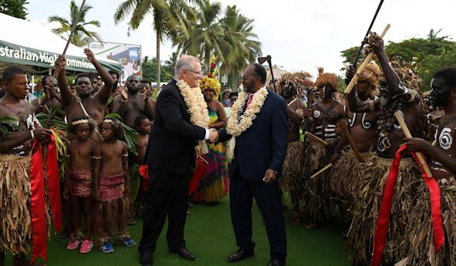 Australian Prime Minister Scott Morrison shakes hands with Prime Minister of Vanuatu Charlot Salwai during an official visit to the island in January. Photo: EPA