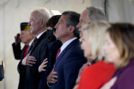 President Joe Biden stands as a rendition of the national anthem is performed during a Memorial Day event at Veterans Memorial Park at the Delaware Memorial Bridge in New Castle, Del., Sunday, May 30, 2021. (AP Photo/Patrick Semansky)