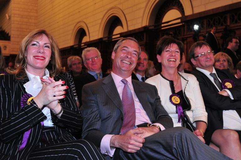 UK Independence Party (UKIP) leader Nigel Farage (2L) smiles sitting with Janice Atkinson (L) at Southampton Guildhall on May 25, 2014