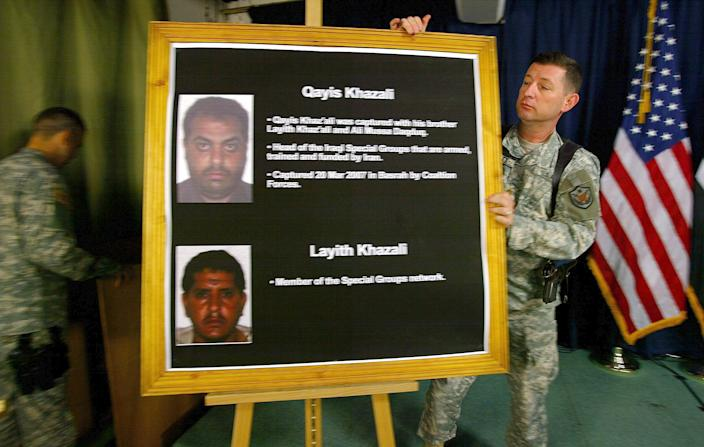 A U.S. officer in Baghdad in 2007 with a board showing Iraqi Shiite leader Qayis Khazali and his brother Layith. Under interrogation, Qayis Khazali revealed that Iran's Quds Force helped militants carry out an attack that year in Karbala, Iraq, in which five Americans were killed. (Photo: Wathiq Khuzaie/AP)
