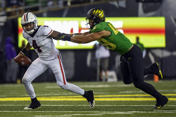 Arizona quarterback Jordan McCloud (4) is sacked by Oregon linebacker Treven Ma'ae (48) during the fourth quarter of an NCAA college football game Saturday, Sept. 25, 2021, in Eugene, Ore. (AP Photo/Andy Nelson)
