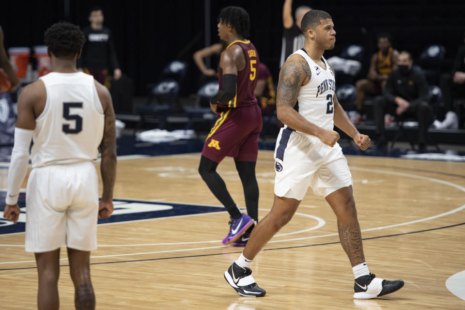 Penn State guard Myles Dread (2) celebrates after scoring a buzzer-beater 3-point shot against Minnesota during an NCAA college basketball game Wednesday, March 3, 2021, in State College, Pa. (Noah Riffe/Centre Daily Times via AP)
