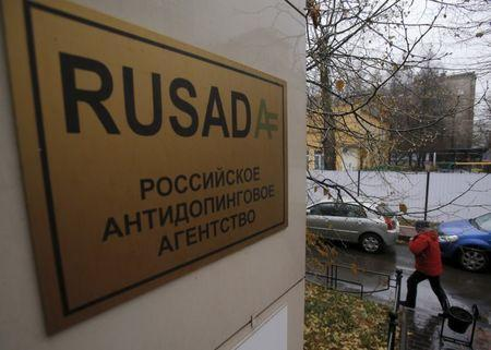 A man walks outside an office of the Russian Anti-Doping Agency (RUSADA) in Moscow, Russia, November 10, 2015. REUTERS/Maxim Shemetov