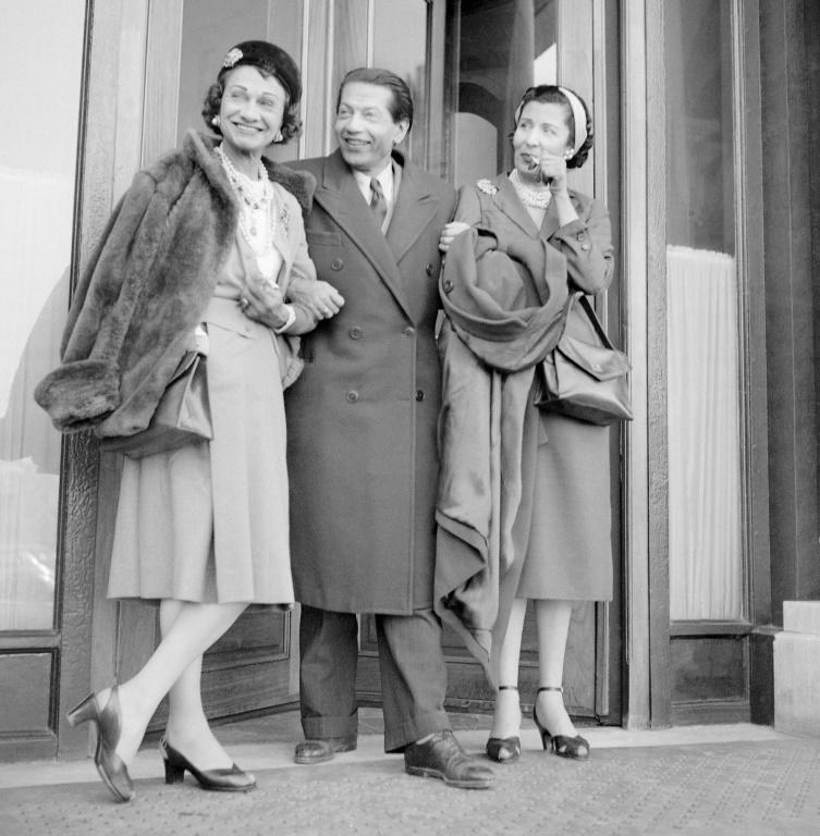 All forgotten: Chanel (L) on her return to Paris in 1953 with Russian dancer and choreographer Serge Lifar and the Baroness de Zuylen
